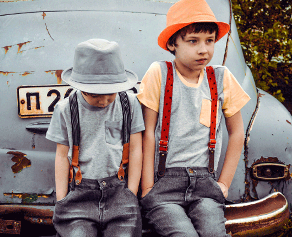 Sad school-age and angry tween kids experiencing a mindful timeout while sitting on an old car